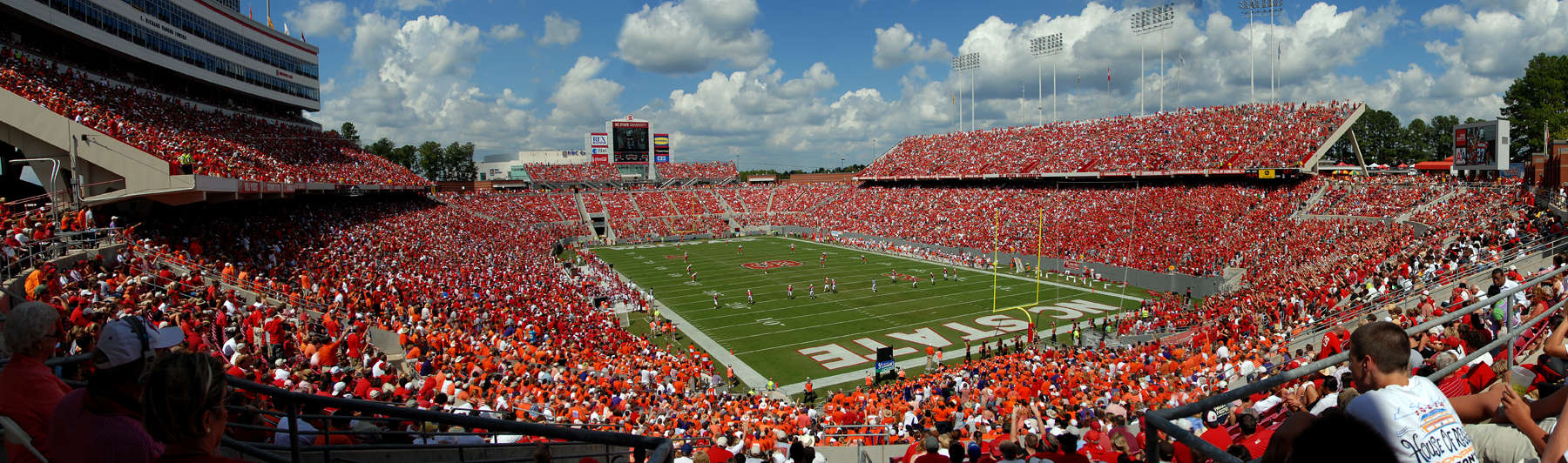 Fans packed into the stands create a sea of red in Carter-Finley Stadium