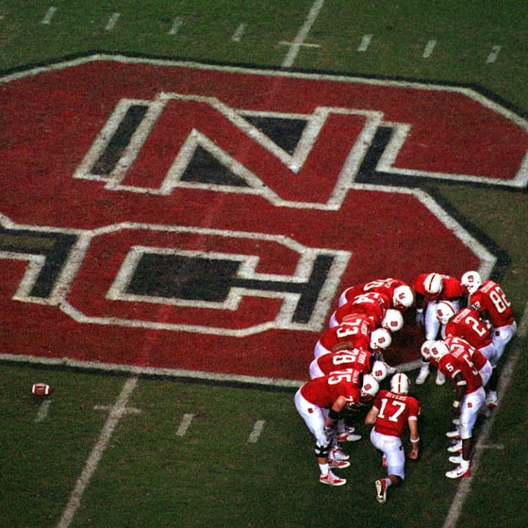 Players huddle on the field