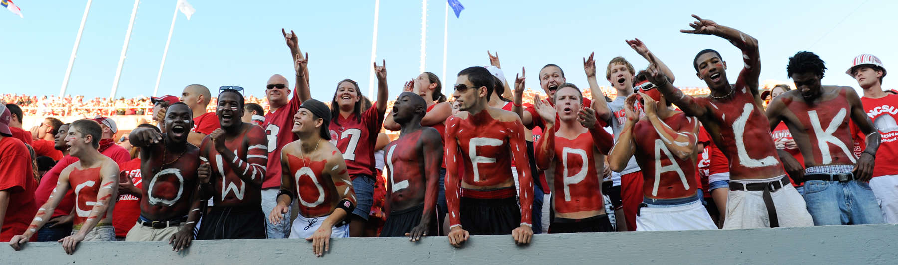 NC State fans go all-out with the red and white paint as they cheer on the Pack during a game against Western Carolina at Carter-Finley stadium in September of 2010.