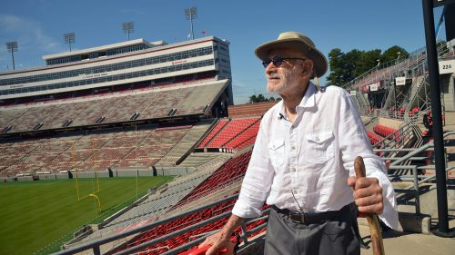 Former NC State design professor Charles Kahn looks out at Carter-Finley, the stadium he designed.