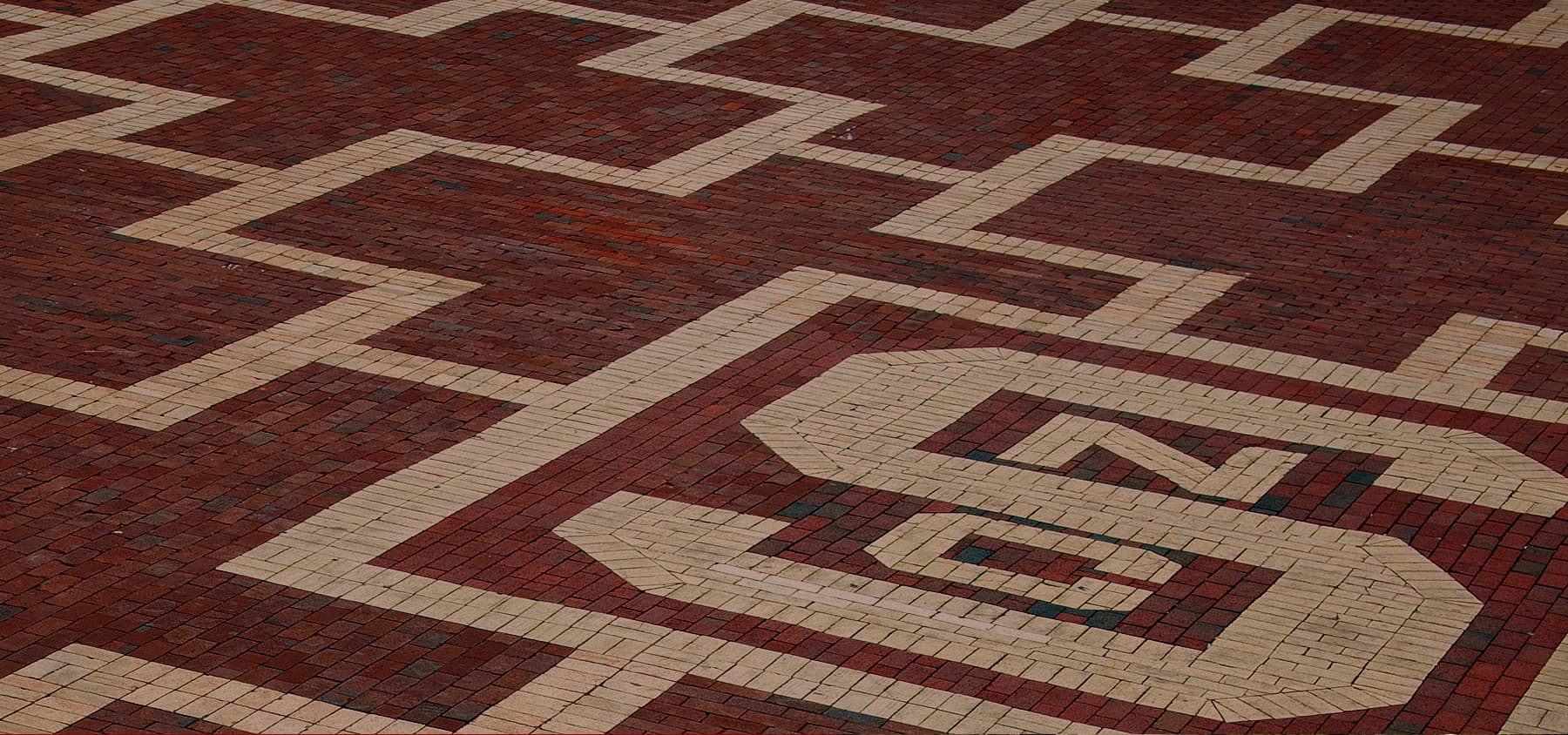 Patterned area of bricks with the NC State block S logo